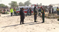Rescue Teams and Ambulances at Fruit Market Blast Site in Islamabad on 09-04-14 Stock Footage