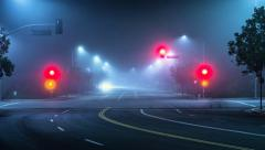 4K. Street intersection traffic at foggy night in Los Angeles, Timelapse Stock Footage