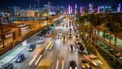 4K. Stream of traffic entering Los Angeles International Airport LAX at night. Stock Footage