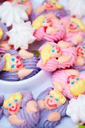 Star and women shaped meringues on white platter Stock Photos