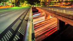 City traffic timelapse, fast pan across freeway bridges. Abstract background. Stock Footage