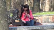 Stock Video Footage of a pair of young girls on a bench