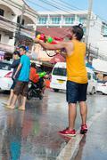 Celebration of songkran festival, the thai new year on phuket Stock Photos