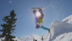 SLOW MOTION: Snowboarding handplant over the sun Stock Footage