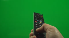Television Remote On A Green Screen Pushing Volume Button, Chroma Stock Footage