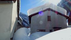 Snowcapped homes. houses covered with snow. winter season sunshine Stock Footage