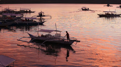 Tourist motor boats floats on the sea near island Coron at sunset, Philippines - stock footage