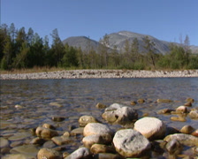NORWAY: Atna river gently running - low angle - pebbles and rubble - stock footage