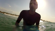Stock Video Footage of UNDERWATER: Young surfer waiting for a wave