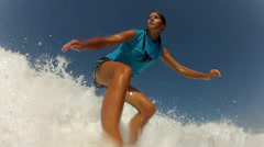 Female surfer riding waves Stock Footage