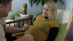 Expectant father and mother have some quality time Stock Footage