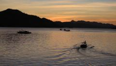 Wonderful sunset at sea with boat. Beautiful lagoon in Island Coron, Philippines - stock footage