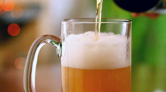 Pouring beer into mug Stock Footage