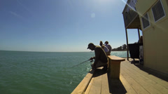 PIER PEOPLE FISHING 1 - stock footage