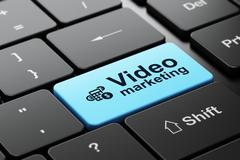 Finance concept: Calculator and Video Marketing on computer keyboard background Piirros