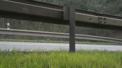A crash barrier and roadside with going truck Stock Footage