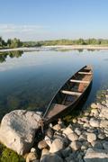 Pirogue on a river Stock Photos