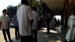 Seminarians walk on seminary lobby Stock Footage