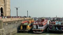 India Maharashtra District Mumbai 028 boats at the shore next to the landmark Stock Footage