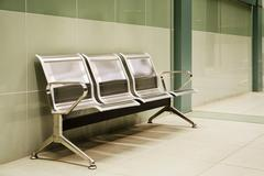 Metalic benches at the last subway station - stock photo