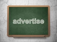 Advertising concept: Advertise on chalkboard background Stock Illustration