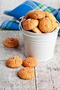 Meringue almond cookies in bucket Stock Photos
