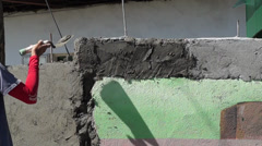 Mason trowels cement plaster wall Stock Footage