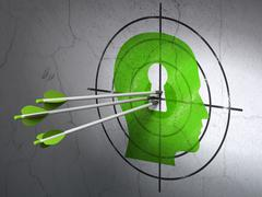 Education concept: arrows in Head With Keyhole target on wall Stock Illustration