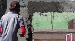 Mason cement plaster wall Stock Footage