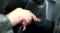 Car start with key Stock Footage
