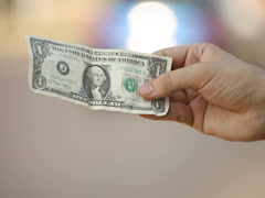 young adult woman hand displaying one dollar banknote - stock footage