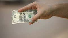 Young adult woman hand displaying one dollar banknote Stock Footage