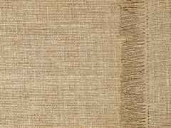 linen texture pattern with fringe as background. - stock photo