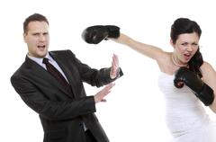 bad relationship. funny wedding couple expressive fighting. woman showing her - stock photo