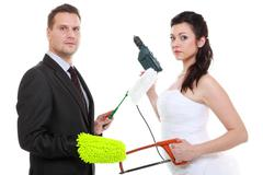 feminism emancipation concept. humorous funny couple bride groom in domestic  - stock photo