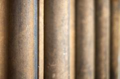 Shallow depth of field on receding worn stone pillars Stock Photos