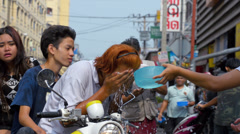 Young Man Washing Face and Getting Splashed During the Songkran Festival Stock Footage