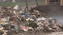 Truck moving garbage in a landfill site Stock Footage