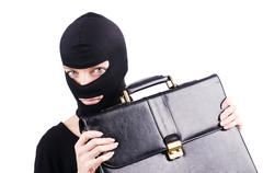 Industrial espionage concept with person in balaclava Stock Photos