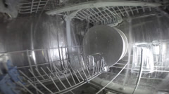 Dishwasher makes dishes glasses utensils clean and bright - stock footage