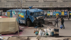 debris fromukraine protests and truck with 'Ukraine' graffiti - stock footage