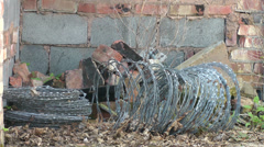 Bales of barbed wire, cut away shot Stock Footage