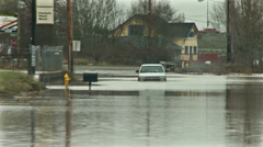 Stock Video Footage of Flooded street. Flooded neighbor. Flooded car