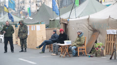 Demonstrators outside makeshift tents at maidan square in ukraine Stock Footage