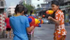Young Boys Shooting Water Pistols at Each Other During the Songkran Festival Stock Footage