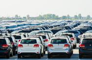 Stock Photo of TUSCANY, ITALY - 27 June: New cars parked at distribution center