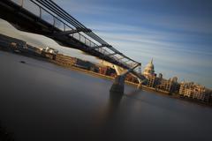millennium bridge and st. paul cathedral - stock photo