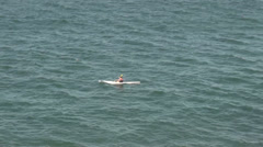 A lone canoeist at sea - stock footage