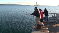 Three men wharf fishing Stock Footage