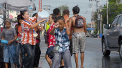 Young Thai Boy Dancing During a Water Fight in the Songkran Festival Stock Footage